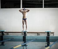 Swimmer standing on starting block Royalty Free Stock Photography