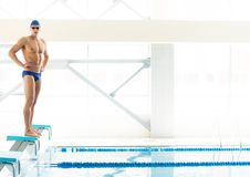 Swimmer standing on starting block Stock Photo