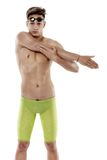 Swimmer stretching. Studio shot over white. Young adult male swimmer stretching. Studio shot over white Stock Images