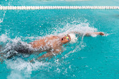 Swimmer swimming backstroke Royalty Free Stock Photography