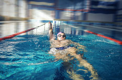 Swimmer swimming backstroke Stock Photo