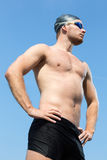 Swimmer with swimming goggles posing with blue sky Stock Images