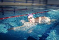 Swimmer swimming. Man swimmer swimming crawl in blue water Stock Image