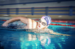 Swimmer swimming. Man swimmer swimming crawl in blue water Royalty Free Stock Photo