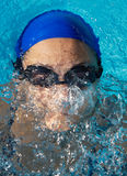 Swimmer in swimming pool. Photo of a swimmer doing spring Stock Photos