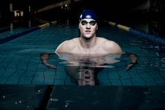 Swimmer in swimming pool Stock Photo