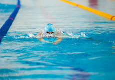 Swimmer swims in water royalty free stock photos