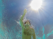 Swimmer swims in water Stock Photography
