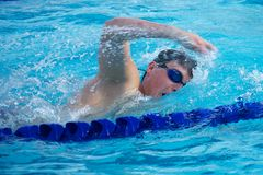 Swimmer Taking a Quick Breath Doing Freestyle royalty free stock image
