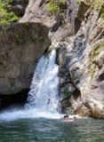 Swimmer taking selfie in water, Iadolina waterfall