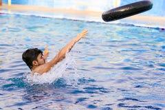 Swimmer throwing lifesaver Stock Photos