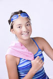 Swimmer with towel over shoulder. Royalty Free Stock Images