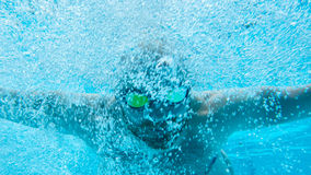 Swimmer Under Water in Pool Stock Photo