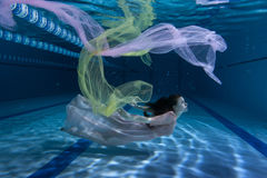 Swimmer underwater playing with cloth. Royalty Free Stock Photography