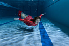 Swimmer underwater in the pool. Swimmer in the pool, she swims on the bottom Royalty Free Stock Images