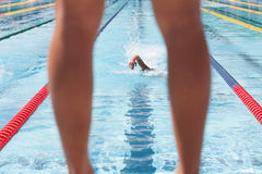 Swimmer waiting for his team member during a relay Royalty Free Stock Photo