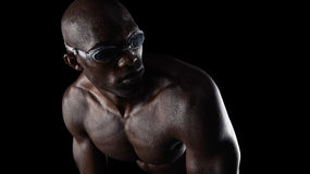 Swimmer wearing goggles looking over shoulder Stock Photo