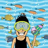 Swimmer wearing snorkel with seashell Stock Image