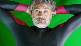 Swimmer in wetsuit. Mature man, open water swimmer in wetsuit over green screen stock video