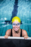 Swimmer woman lean on the edge of the swimming pool Stock Image