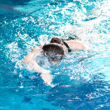 Swimmer woman performing the crawl stroke. Swimmer diving performing the crawl stroke Royalty Free Stock Photo