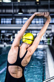 Swimmer woman stretching at edge of the swimming pool Royalty Free Stock Images
