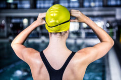 Swimmer woman stretching at edge of the swimming pool Royalty Free Stock Photo