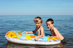 Swimmers. Two brothers playing in the water - kids royalty free stock photos