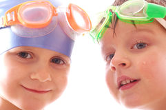 Swimmers. Two concentrated kids with goggles on their heads Royalty Free Stock Image
