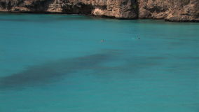 Swimmers in a bay. On Curacao stock video