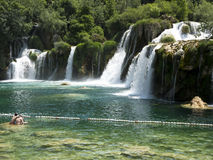 Swimmers in the crystal clear water of Krka river at Krka National Park Croatia. Royalty Free Stock Photography