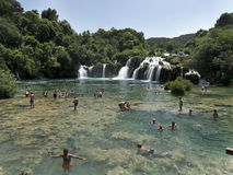 Swimmers in the crystal clear water of Krka river at Krka National Park Croatia. Stock Image