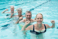Swimmers enjoying in swimming pool. Portrait of swimmers enjoying in swimming pool Royalty Free Stock Image