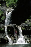 Swimmers at falls. Swimmers, Oheo Gulch (7 Pools), Haleakala NP, Maui Royalty Free Stock Photos