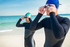 Swimmers getting ready at the beach Stock Photography