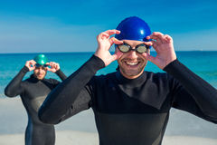 Swimmers getting ready at the beach Stock Images