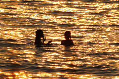 Swimmers in Lake Huron at Sunset Stock Images