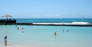 Waikiki Beach, Honolulu, Hawaii, USA. Tourists swimming in calm water at a Waikiki Beach, Honolulu city, Oahu Island, Hawaii Royalty Free Stock Images