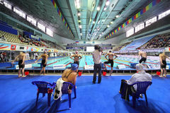 Swimmers prepare start on opened championship Royalty Free Stock Image