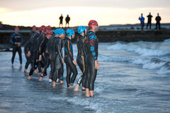 Swimmers prepare to start. GALWAY - SEPTEMBER 4: Pro athletes prepare to start at first Edition of Galway Iron Man Triathlon on September 4, 2011 in Galway Royalty Free Stock Image
