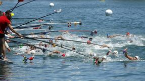 Swimmers at the Refreshment point. Of the open waters event during a Len European open waters swimming CUP on July 1, 2017 in Barcelona Spain Royalty Free Stock Photo