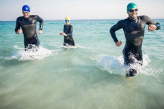 Swimmers running in the ocean Stock Photos