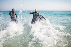 Swimmers running in the ocean Stock Photo