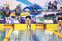 Swimmers start at the Championship of Russia on swimming. MOSCOW - APR 20: Swimmers start at the Championship of Russia on swimming in Olympic Sports complex, on Royalty Free Stock Photos