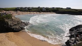 Swimmers in the surf and waves Treyarnon Bay Cornwall England UK Cornish north coast between Newquay and Padstow summer stock video