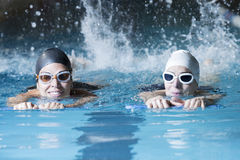 Free Swimmers Swimming With A Swim Board Stock Image - 58368641