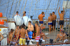 Swimmers on tall ship board Royalty Free Stock Photos