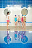 Swimmers with teacher Royalty Free Stock Photos