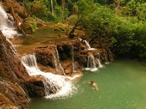 Swimmimg in tourquise Kouang Si Waterfall in Laos Stock Image