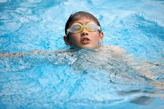 Swimminfg boy in glasses Royalty Free Stock Photos